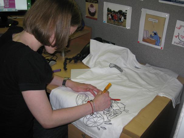 Sarah coloring her Scribble Tee